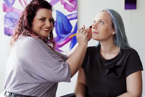 Fashion and bridal makeup course instructor demonstrating on a model