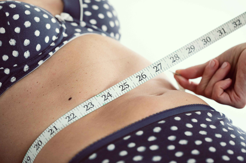 tape measure and tummy in a body wrap course at Bristol Beauty School