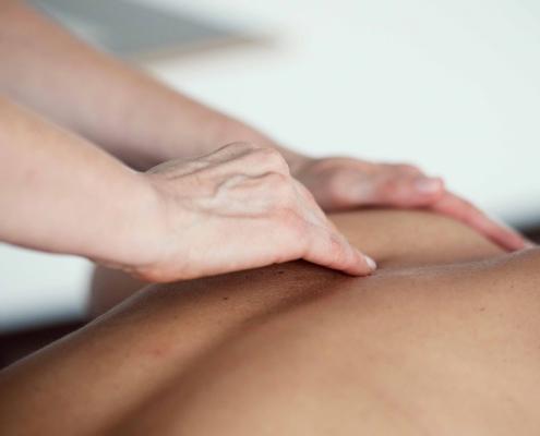 hand and back having a swedish massage at Bristol School of Beauty