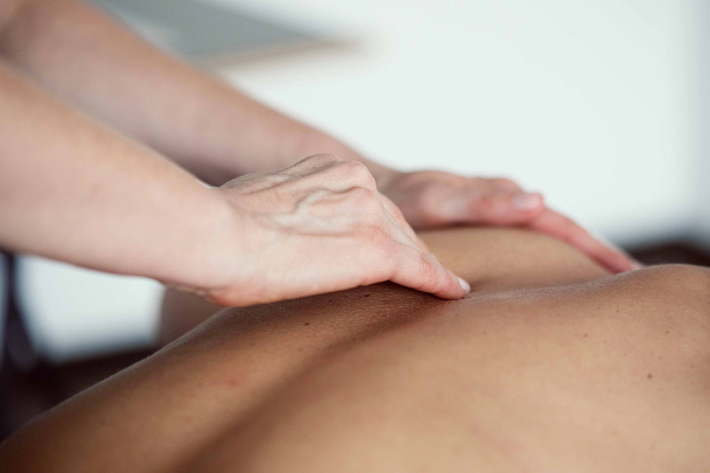 hand and back having a swedish massage at Bristol School of Beauty