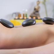 hot stone massage course - lady having a hot stone massage