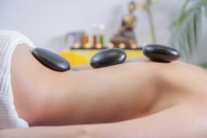 hot stone massage course - lady having a hot stone massage