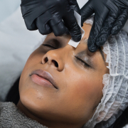 lady having a brow waxing treatment