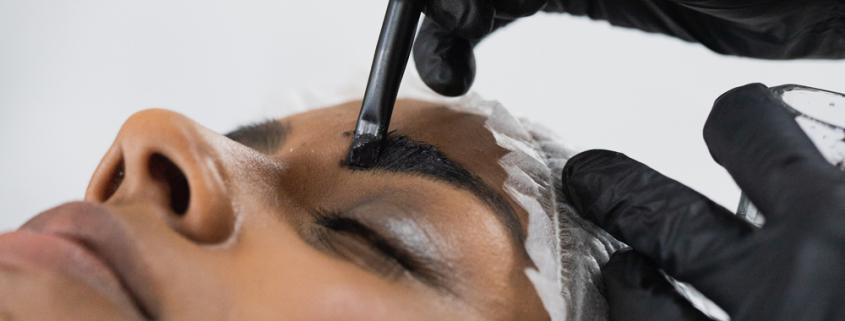 lady having a henna brow treatment